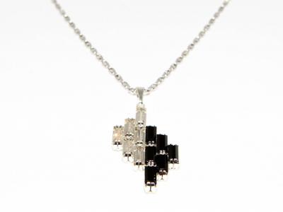 Simple rhinestone pendant on a chain.